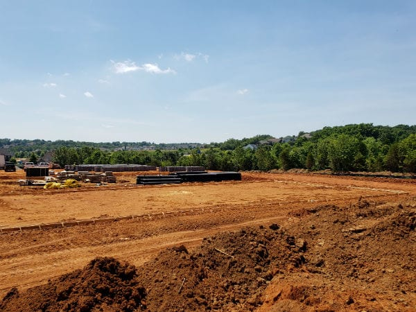 View of Prime West Knoxville construction site with trees in the distance