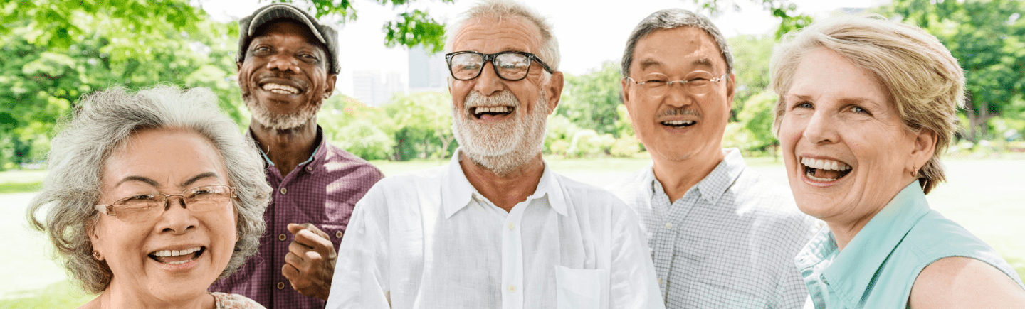 group of smiling seniors in the park