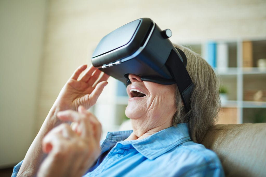 Astonished senior woman with vr glasses