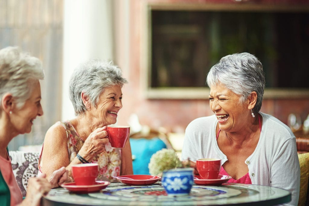 Shot of a group of elderly friends having coffee together