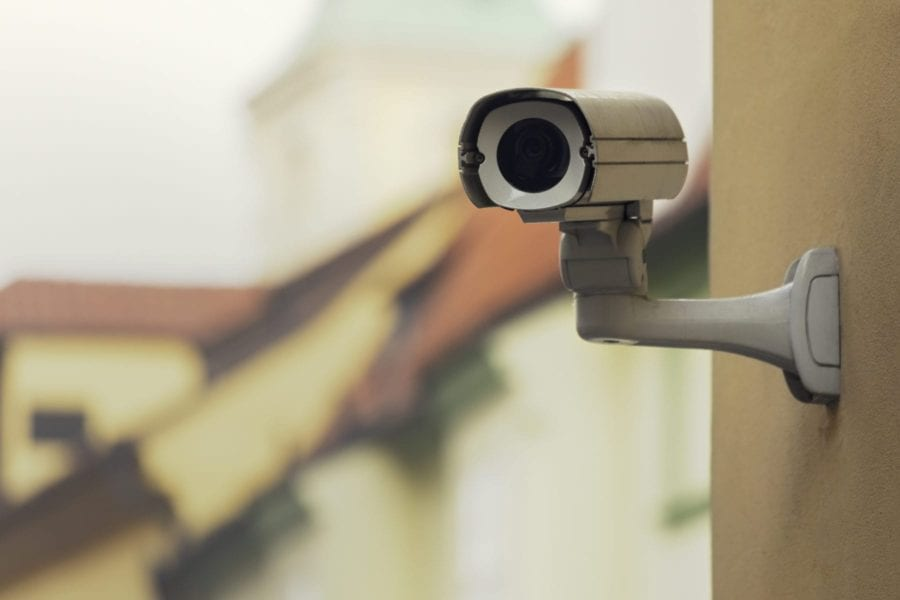 A security camera on an senior living apartment building wall