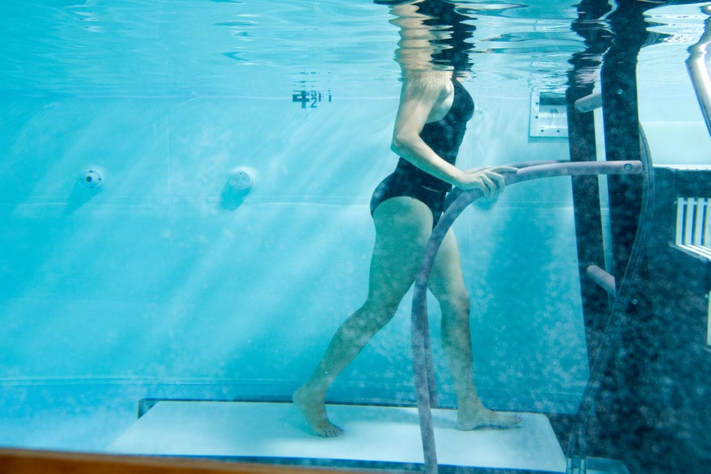 woman using the physical therapy underwater aquatic treadmill