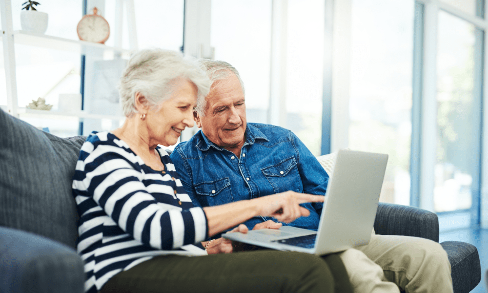 senior couple looking up prime west knoxville on computer